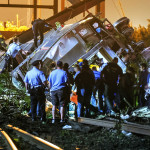 Image: Rescue workers climb into the wreckage of a crashed Amtrak train in Philadelphia